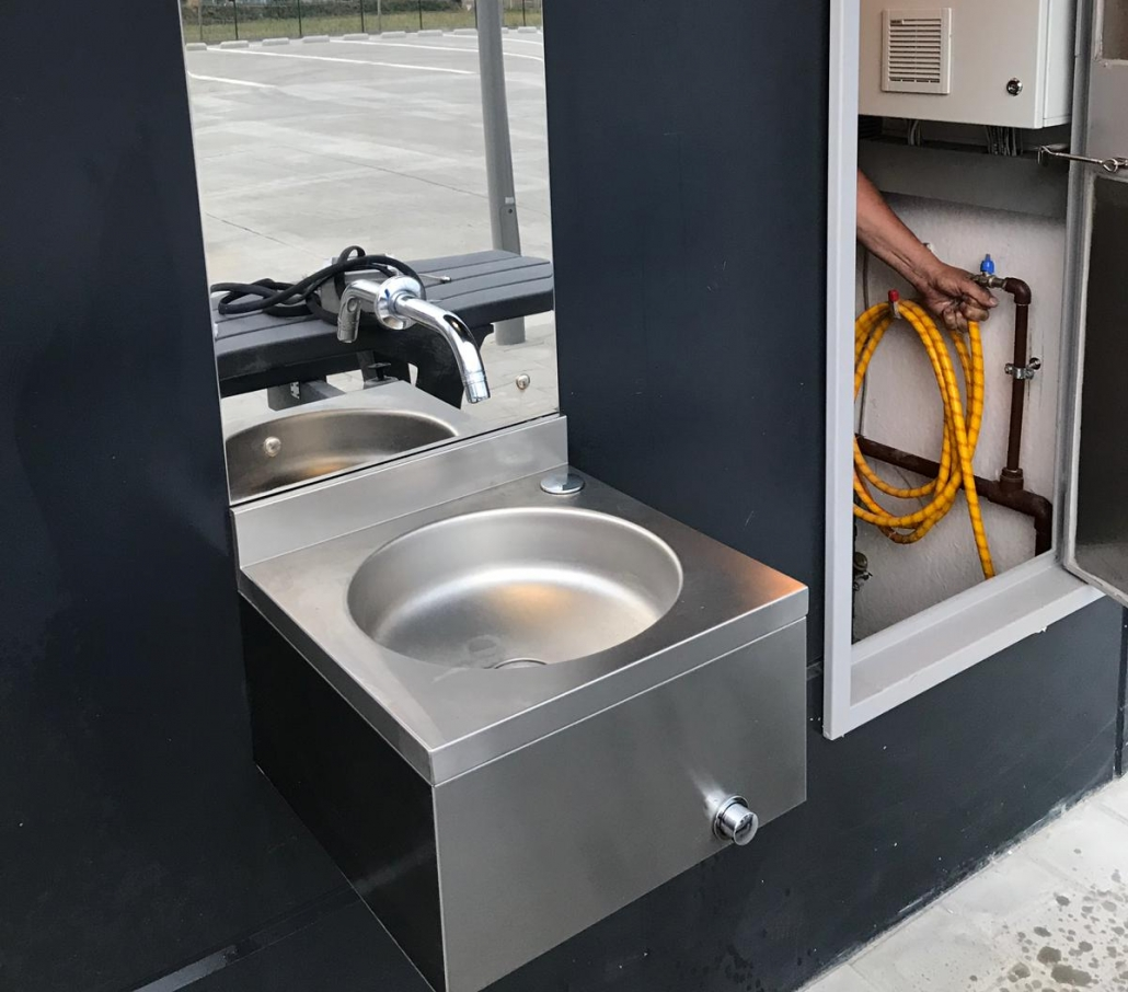 self cleaning toilet with external fountain